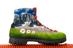 Climbing Boot with Mountain Inside Royalty Free Stock Photos