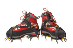 Climbing boots with the crampo. Ns isolated on the white background Stock Images