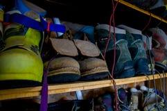 Climbing boots in an outdoor shoe shelf Royalty Free Stock Photo