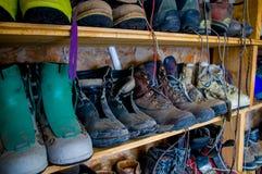 Climbing boots in an outdoor shoe shelf Stock Photos