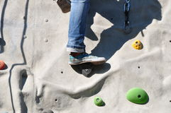 Climbing a boulder wall Royalty Free Stock Images