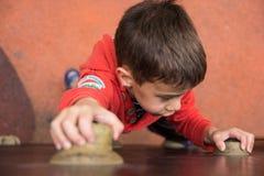 Climbing boy Stock Photography