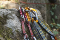 Climbing. A bunch of carabiners on the rocks Royalty Free Stock Photos