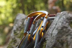 Climbing. A bunch of carabiners on the rocks Royalty Free Stock Photography