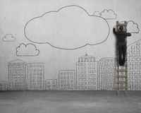 Climbing businessman drawing clouds with copy space on concrete Royalty Free Stock Photo
