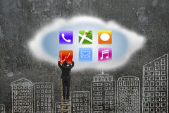 Climbing businessman getting app icons from cloud with doodles w Stock Photos
