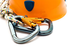 Climbing carabiner and helmet Stock Photography