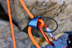 Climbing carabiner. On orange rope, close up royalty free stock photos