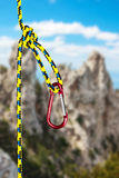 Climbing carabiner on the rope Stock Photos