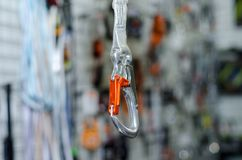 A carabiner or karabiner. Is a specialized type of shackle, a metal loop with a spring-loaded gate used to quickly and reversibly connect components, most royalty free stock image