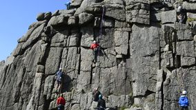 Climbing causing destruction to 1000 year old rock formation on dartmoor national park stock video