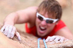 Climbing challenge. Man climber using all strength, focus and courage