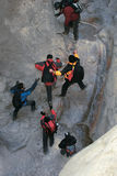 Climbing cliff. The hikers are climbing the cliff in Yixiantian Canyon in Taiyuan, Shanxi, China Stock Photo