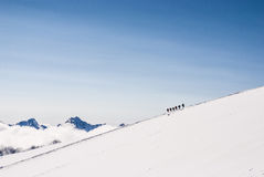 Climbing climbers on the snowy mountain top. Royalty Free Stock Photography