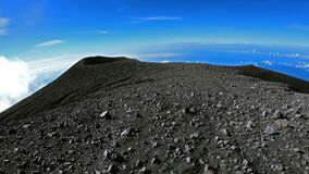 Climbing the crater of Semeru. Backpacker walking around Semeru crater on the top of mountain. POV shot first person veiw on breat
