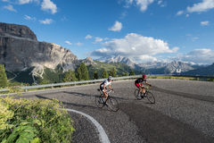 Climbing with the cycle to the pass-marmolada-dolomites. Road cycling in the dolomites-world natural heritage Stock Images