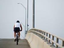 Climbing cycler Stock Image