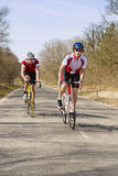 Climbing cyclists Royalty Free Stock Photography