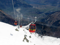 Climbing and descending !. Cable car in austrian mountains stock photography