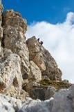 Climbing in the dolomites rock - portrait. A couple on ferrata-climbing in the dolomites - The Dolomites - UNESCO World Heritage - portrait format Stock Image