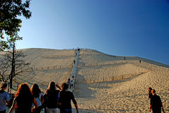 Climbing Dune du Pyla, Gironde. The Dune of Pilat (French: Dune du Pilat), is the tallest sand dune in Europe. It is located in La Teste-de-Buch in the Arcachon Stock Image