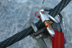 Climbing equipment. Climbing carabiner on a steel rope - via ferrata Stock Photography