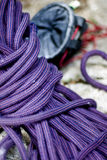 Climbing equipment. Closeup on purple stretching climbing rope and magnesium powder satchel Royalty Free Stock Photo