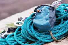 Climbing equipment - A bag for magnesia lies on a climbing rope Royalty Free Stock Image