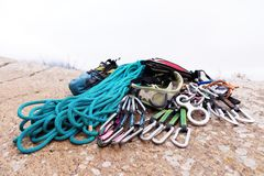 Climbing equipment - rope and carbines view from the side close-up. A coiled climbing rope lying on the ground as a Royalty Free Stock Photos