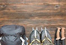 Climbing equipment: black backpack, trekking shoes, trekking pol Royalty Free Stock Image