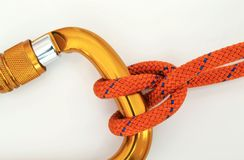 Climbing equipment - carabiner and knot Royalty Free Stock Images