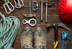 Climbing equipment on dark wooden background, top view royalty free stock image