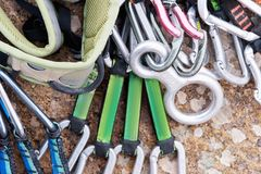 Climbing equipment - a harness and a rope next to the carbines lie on a rock Stock Image