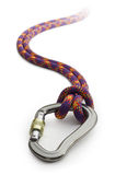 Climbing equipment. Karabiner tied to climbing rope and fading into the distance Royalty Free Stock Images