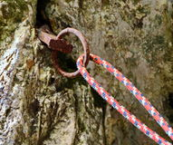 Climbing equipment. Old climbing piton peg and rope Royalty Free Stock Images