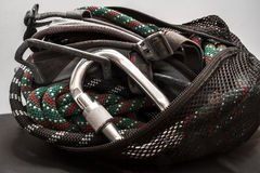 Climbing equipment packed in bag. Royalty Free Stock Photo