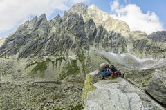 Climbing equipment on the rock with a peak in the background Stock Photography