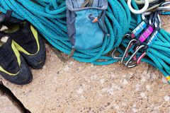 Climbing equipment - rope and carbines view from the top close-up. A coiled climbing rope lying on the ground as a Stock Photos