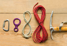 Climbing equipment: rope, ice tools, ice ax, eight, carbine on wooden background, top view Royalty Free Stock Photos