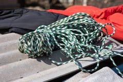 Climbing equipment. rope lies next to a sleeping bag for tourism stock photos
