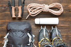 Climbing equipment: rope, trekking shoes, crampons and other set Royalty Free Stock Photo