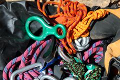 Climbing equipment shackles harnesses ropes Stock Photography