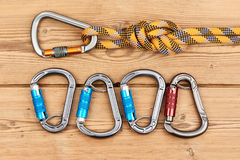 Climbing equipment. On wooden background Royalty Free Stock Photos