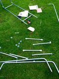 Climbing frame construction in back garden. Putting together a children's side and climbing frame royalty free stock images
