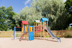 Climbing frame with slide on playground at summer Stock Images