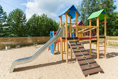 Climbing frame with slide on playground at summer Royalty Free Stock Photo