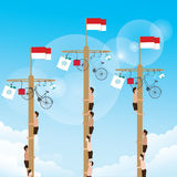 Climbing game with hanging prize at the top Indonesian celebrate independence day Stock Image