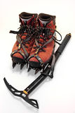 Climbing gear. Boots, crampons and an ice axe Stock Images