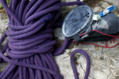 Climbing gear. Closeup on magnesium satchel, rope and tooth brush for cleaning grips Royalty Free Stock Photo
