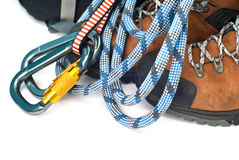 Climbing gear - carabiners, rope and boots Stock Photography